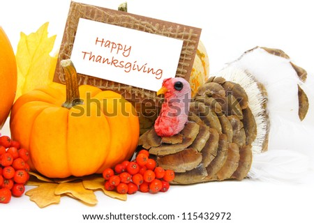 Happy Thanksgiving card with pumpkin and turkey decor over white - stock photo