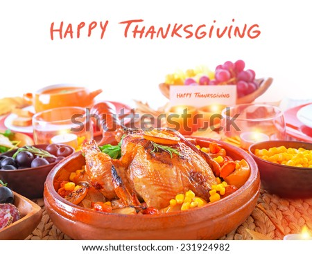 Happy Thanksgiving day, festive table setting with text space, tasty oven baked turkey and vegetables for holiday dinner, decorated with nice little candle  - stock photo