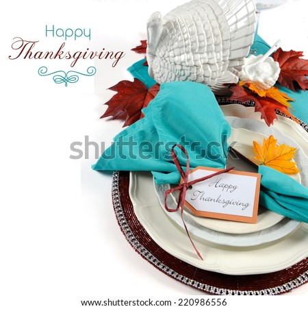 Happy Thanksgiving dining table place setting with vintage turkey tureen in Autumn brown and aqua color theme with copy space and sample text. - stock photo