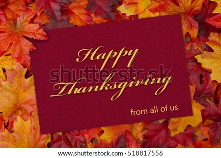 Happy Thanksgiving Greeting Card, Some fall leaves and a greeting card with text Happy Thanksgiving from all of us