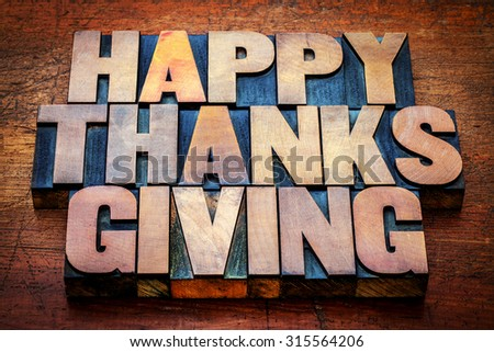 Happy Thanksgiving greetings card or sign -  text in vintage letterpress wood type blocks stained by color inks - stock photo
