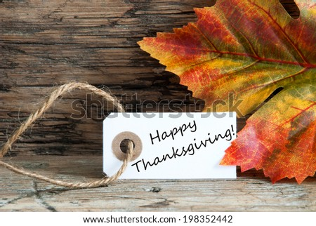 Happy Thanksgiving on a Autumn Background Label - stock photo
