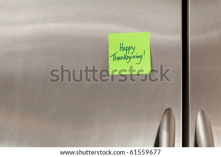 Happy Thanksgiving sticky note on a refrigerator - stock photo