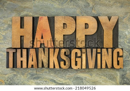 Happy Thanksgiving  - text in vintage letterpress wood type blocks against slate rock background - stock photo