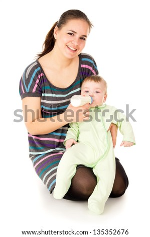happy the mother feeds her baby isolated on white background