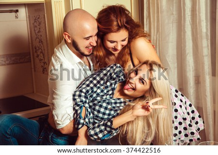 Happy three friends having fun at house party. Celebrate, disco, party, nightlife, entertainment, friendship concept. - stock photo