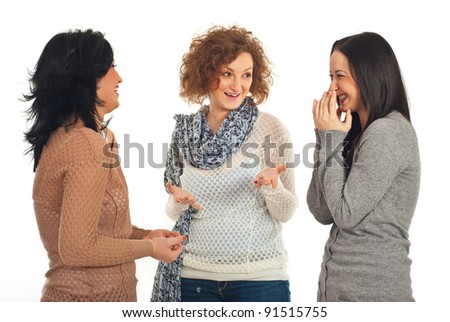 Happy three friends women having conversation and laughing together isolated on white background - stock photo