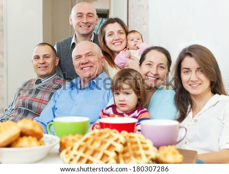 happy three generations family communicate over tea - stock photo
