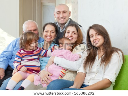 Happy three generations family in home interior  - stock photo