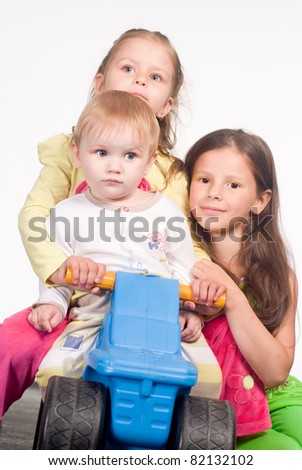 happy three kids playing on a white - stock photo
