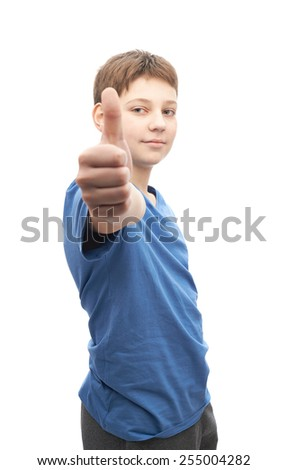 Happy thumbs up young boy portrait isolated over the white background - stock photo
