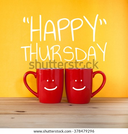 Happy thursday word.Two cups of coffee and stand together to be heart shape on yellow background with smile face on cup. - stock photo