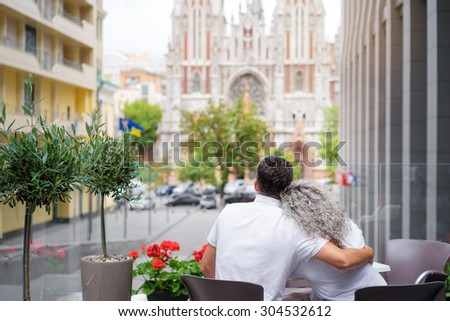 Happy to be together. Elderly family couple sitting in sidewalk cafe. - stock photo