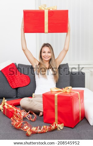 Happy to get that perfect present for Christmas - stock photo