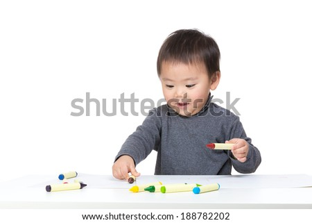 Happy toddler boy drawing - stock photo
