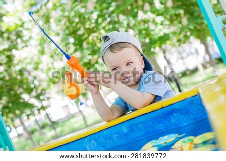 Happy Toddler boy playing in the fishing - stock photo