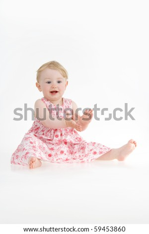 Happy toddler claps on white background. - stock photo