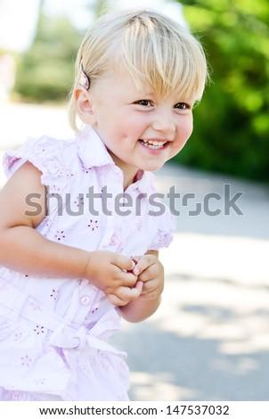 happy toddler girl in summer - stock photo