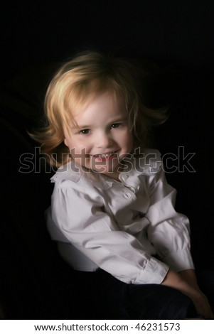happy toddler girl - studio shot over black