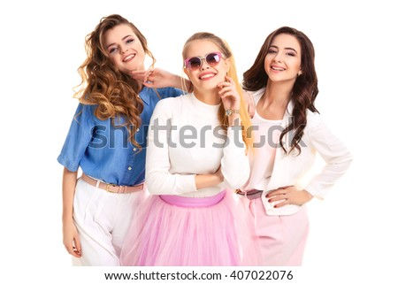 Happy together concept. three pretty girls smile on a white background . Vintage style. Fashion photo. studio photo . White background.  - stock photo