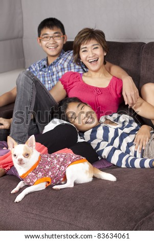 happy together, mother, daughter, son and a dog happy together. - stock photo