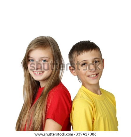 Happy together - teenage boy and girl in yellow and red t-shirts back to back looking forward with smiles isolated on white background in square