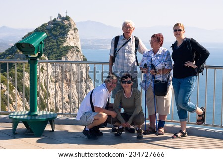 Happy tourist people on the Rock of Gibraltar. - stock photo