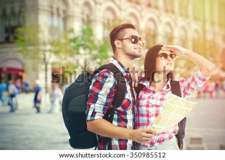 Happy tourists outside - stock photo