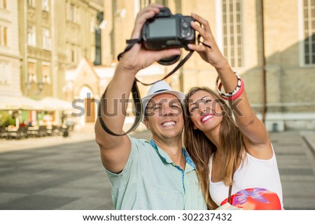 Happy tourists taking photo of themselves - stock photo