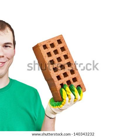 happy tradesman holding a red brick - stock photo