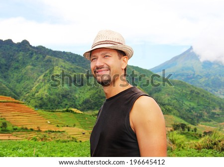 happy traveler in the mountains - stock photo