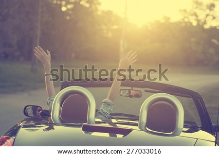 Happy traveler woman in cabrio car - stock photo