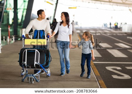 happy traveling family with suitcases at airport - stock photo