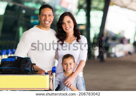 happy travelling family standing at airport - stock photo