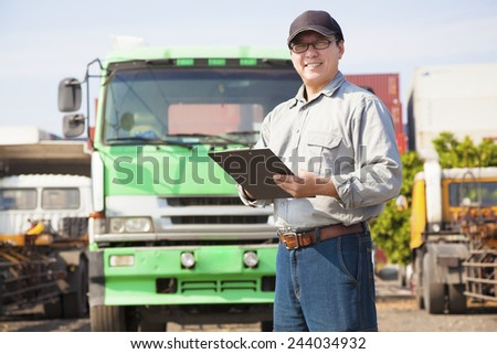 happy truck driver writing on a document - stock photo