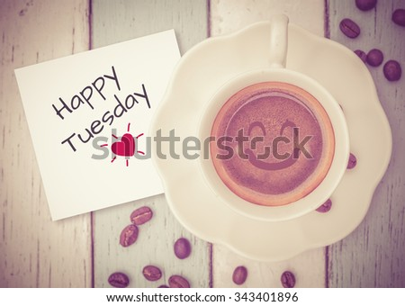 Happy Tuesday with coffee cup on table   - stock photo