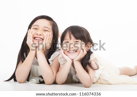 happy two asian girls  on the white background - stock photo