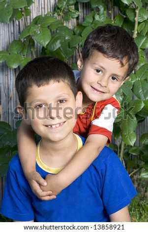 Happy two brothers in park - stock photo