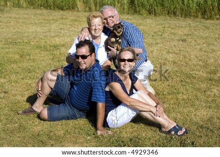happy two older couples posing in the summer