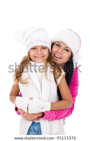 happy two teenage girl excited smile looking at camera, wear warm winter hat over white background - stock photo