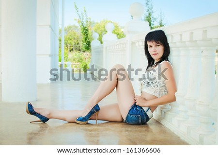 Happy vacation woman summer girl resting and posing in summer park. Beautiful brunette woman outdoors. Sexy summer girl. Trendy summer woman.