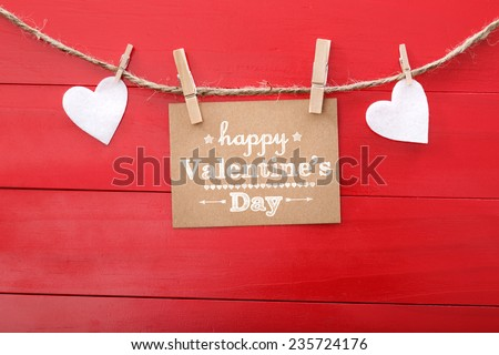 Happy Valentine's Day card with hearts and clothespins on red wood - stock photo