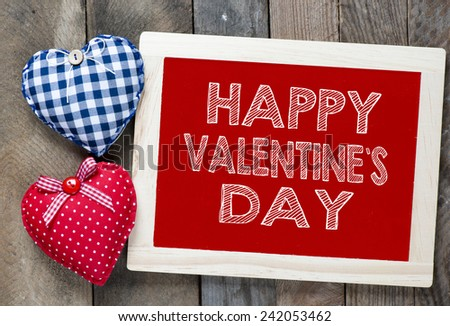 Happy valentine's day frame. Happy valentine's day frame with hearts on wooden background - stock photo