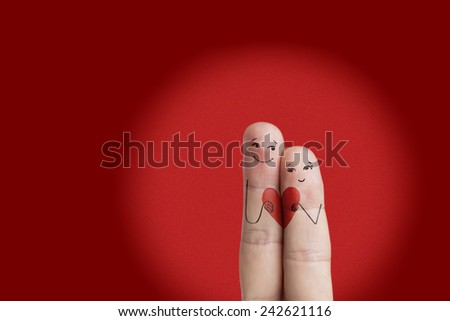Happy Valentine's Day theme series. Painted fingers smile and love. There are path included in image. You can easily cut out fingers from the background. And insert them into a different scene. - stock photo