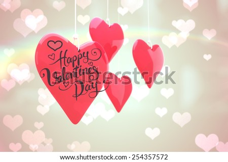 Happy valentines day against heart pattern on abstract design