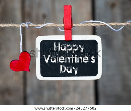 Happy Valentines day frame. Happy Valentines day frame and heart hanging on a rope - stock photo