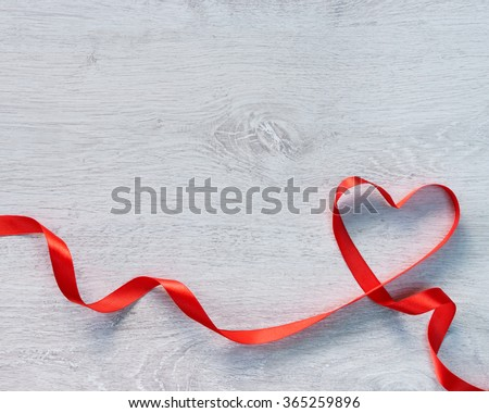Happy Valentines Day. Red Ribbon Heart on a wooden background. Valentines Day concept - stock photo