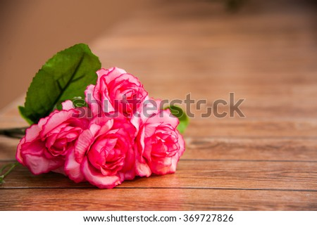 Happy Valentines Day, Special day, Birthday, Anniversary. Roses on wood background and left of frame,right space.Bouquet for special person. - stock photo
