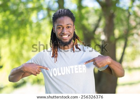 Happy volunteer in the park on a sunny day - stock photo