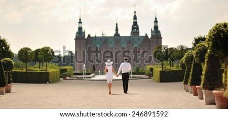 Happy wedding couple walking in park of Denmark.  - stock photo